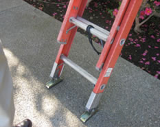 Example of proper placement of ladder on a level surface.