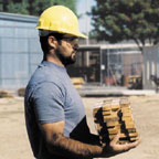 Laborer holding 10 lbs. of wood close to body